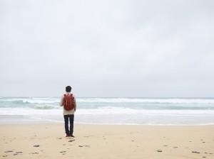 547ce9b72a3d21fa285cb869_solo-travel-man-on-beach